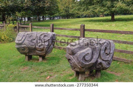 Sheep Carved out of Oak with a Chain Saw in the Grounds at Arlington, Devon, England, UK