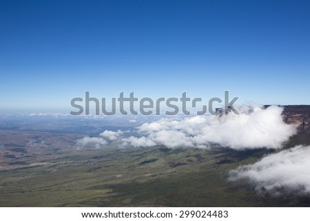 Sheer cliffs of Mount Roraima - landscape with blue sky and clouds background. View on the Gran Sabana. Venezuela 2015.