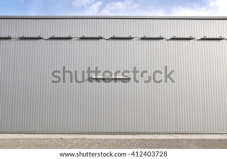 Sheet metal, corrugated wall building - stock photo