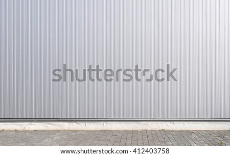 Sheet metal, corrugated wall building - stock photo
