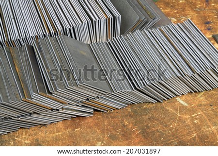 sheet metal stacked together, closeup of photo