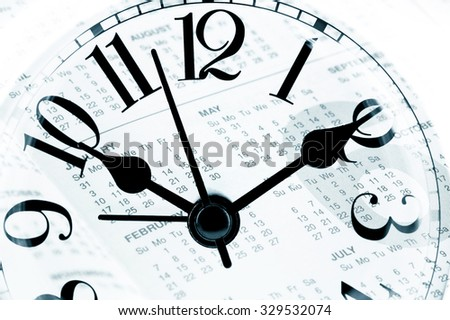 sheet of a calendar with the number of days and clock close-up, concept business - stock photo