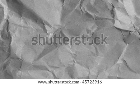Sheet of brown and rippled paper background - (16:9 black and white) - stock photo