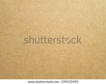 Sheet of brown paper useful as a background - stock photo