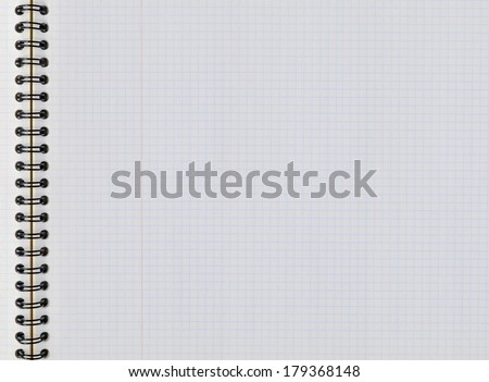 Sheet of graph paper in a horizontal notebook. Study and education concept - stock photo