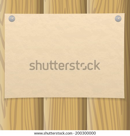 Sheet of old yellowed paper pinned on two thumbtacks on a wooden wall, design background - stock photo