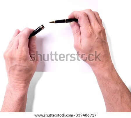 Sheet of Paper and Human Hands Holding a Pen - Isolated