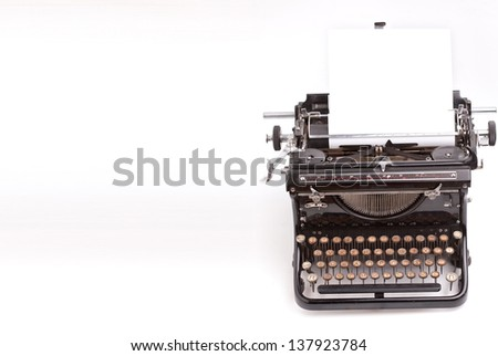 Sheet of paper inserted into the vintage typewriter - stock photo
