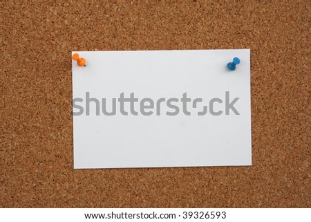 sheet of paper on a cork wall