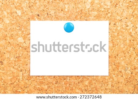 Sheet of paper on cork - stock photo