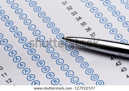 Sheet of standardized test and pen