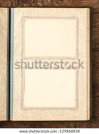 Sheet of the old photo album with photos - stock photo