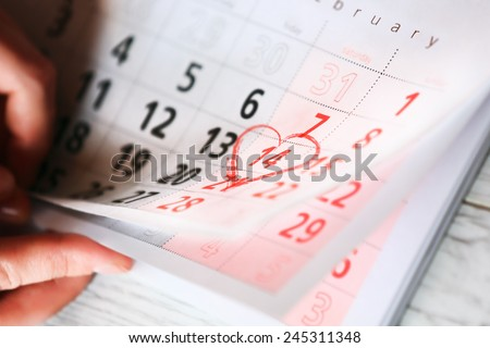 Sheet of wall calendar with red heart mark on 14 February - Valentines day