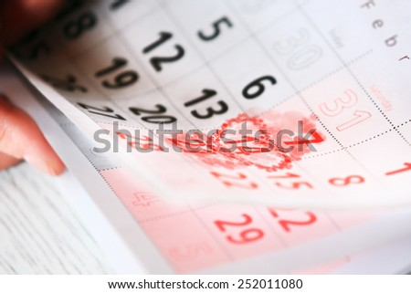 Sheet of wall calendar with red heart mark on 14 February - Valentines day - stock photo