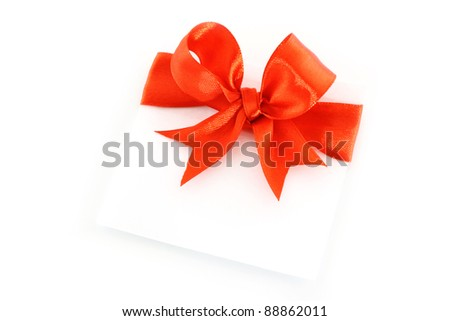 Sheet with red holiday bow on white background - stock photo