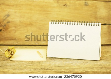 sheets paper  and Empty calendar - stock photo