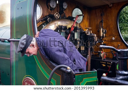 SHEFFIELD PARK, EAST SUSSEX/UK - SEPTEMBER 8 : Fireman of the C Class locomotive at Sheffield Park station East Sussex on September 8, 2013. Unidentified man.