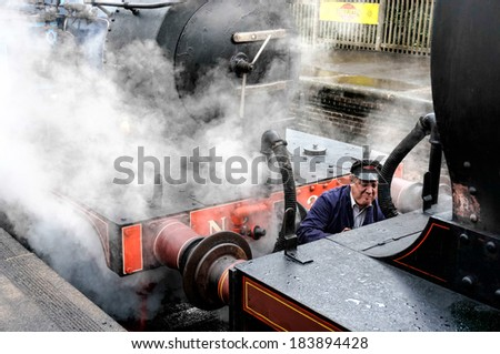 SHEFFIELD PARK, EAST SUSSEX/UK - SEPTEMBER 8 : Unidentified fireman coupling the Bluebell steam engine to a Class C train at Sheffield Park station East Sussex on September 8, 2013