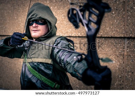 Sheffield, UK - June 11, 2016:  Cosplayer dressed as 'Green Arrow' from DC Comics at the Yorkshire Cosplay Convention at Sheffield Arena