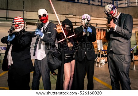 Sheffield, UK - June 12, 2016:  Cosplayers dressed as characters from the video game 'Payday' pose with a female 'Kylo Ren' from 'Star Wars' at the Yorkshire Cosplay Convention at Sheffield Arena