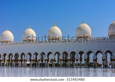 Sheikh Zayed Grand Mosque located in Abu Dhabi - capital city of United Arab Emirates. Mosque was initiated by late President of UAE Sheikh Zayed bin Sultan Al Nahyan. It is largest mosque in UAE. - stock photo