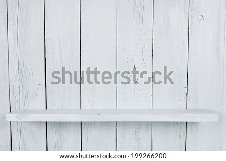 Shelf. A wooden background, a white paint. - stock photo