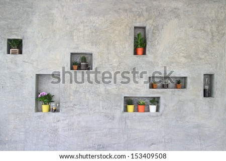 Shelf in wall with flowerpots decoration - stock photo