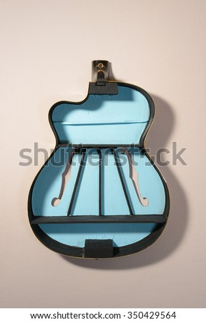 Shelf made of an old classical guitar - stock photo