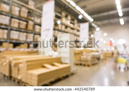 Shelf Of Home Mart Defocused Background Of Furniture Store Industrial  Warehouse Row, Box Blurred Warehouse