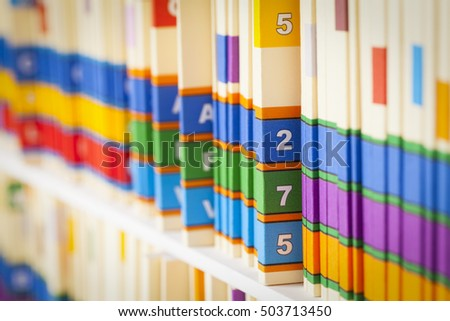Shelf of Medical Files in Office Setting.