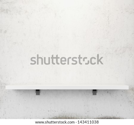shelf on a vintage wall - stock photo