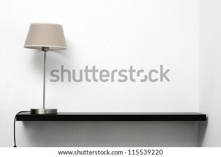 shelf on the wall with lamp - stock photo
