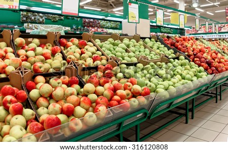 Shelf with fruits in a store, toned image - stock photo