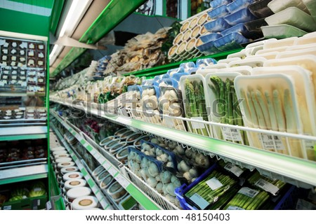 Shelf with groceries in supermarket, tm's removed - stock photo