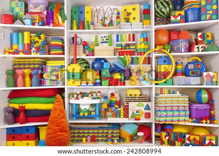 Shelf with many colored toys - stock photo