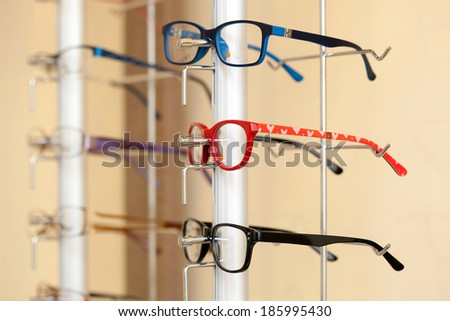 Shelf with modern, beautiful, colored glasses  - stock photo