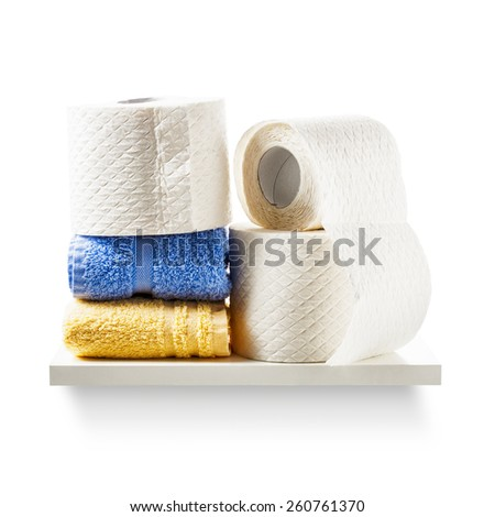 Shelf with toilet paper rolls and towels isolated on white background. Bathroom cabinet. Object with clipping path - stock photo