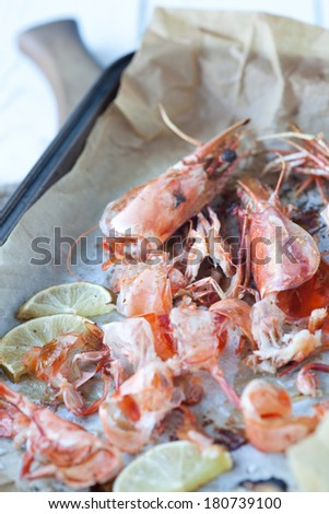 Shell fish scraps in a roasting tin - shallow dof - stock photo