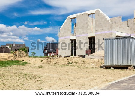 Shell of a house on a construction site - stock photo
