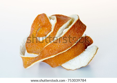 Shell of orange on white table