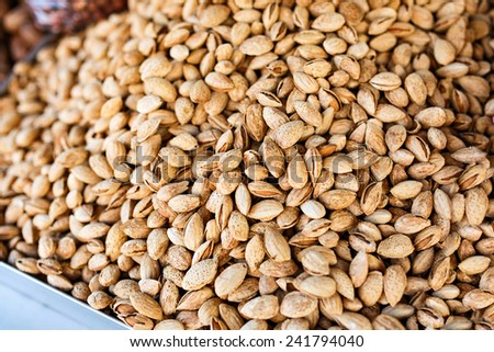 Shelled almonds nuts in a market to sell - stock photo