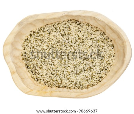 shelled hemp seeds on a rustic wooden tray isolated on white - top view - stock photo
