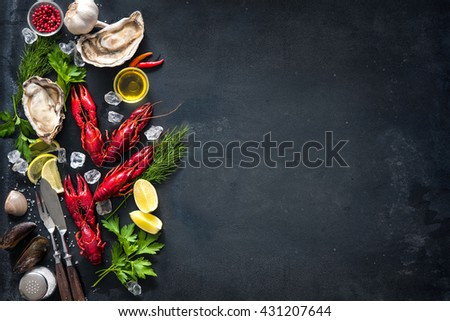 Shellfish plate of crustacean seafood with crayfish, shrimps, mussels, oysters as an ocean gourmet dinner background - stock photo