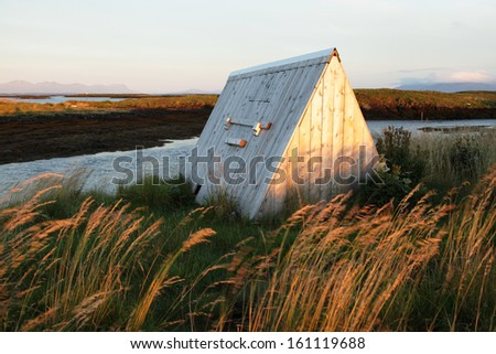 Shelter for eider ducks has a hole for birds, down left. The big door is used by people to fill the seaweed and take out the valuable down. Photo taken et Lanan island in Vega archipelago, Norway.  - stock photo