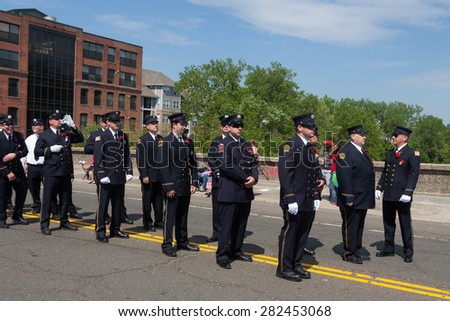 "Shelton, CT, USA - May 25, 2015: The individuals are some of the many participants at the ""Memorial Day Parade"" held in Shelton, Connecticut, on May 25, 2015"