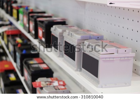 shelves in an auto parts store with storage cells - stock photo