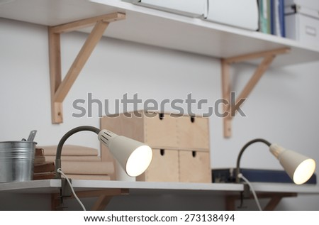Shelves with accessories and spotlights in the home interior - stock photo