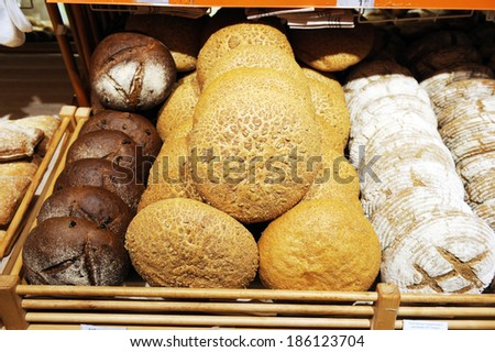 shelves with bread in shop - stock photo