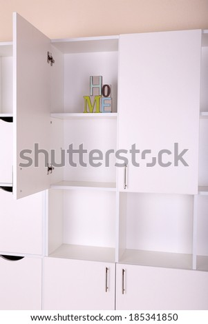 Shelves with decorative letter close up