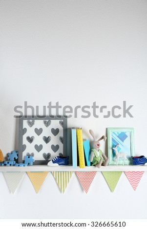 Shelves with toys in child room close-up - stock photo